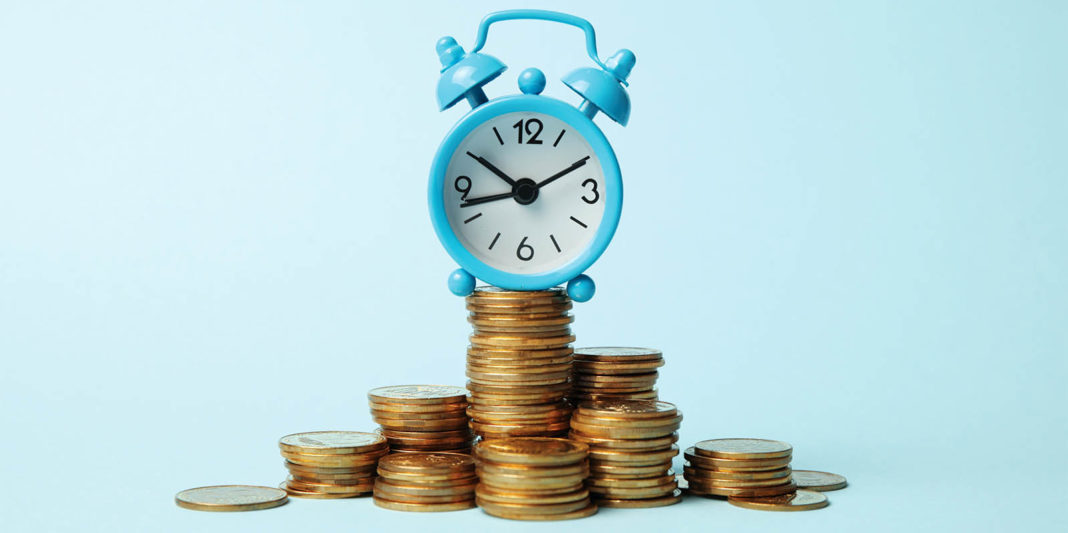 Finance investment, Time is money. Alarm clock and golden money