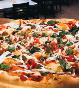 Vegan, thin-crust pizza from Este Pizza, a spot for allergy-friendly takeout in Utah
