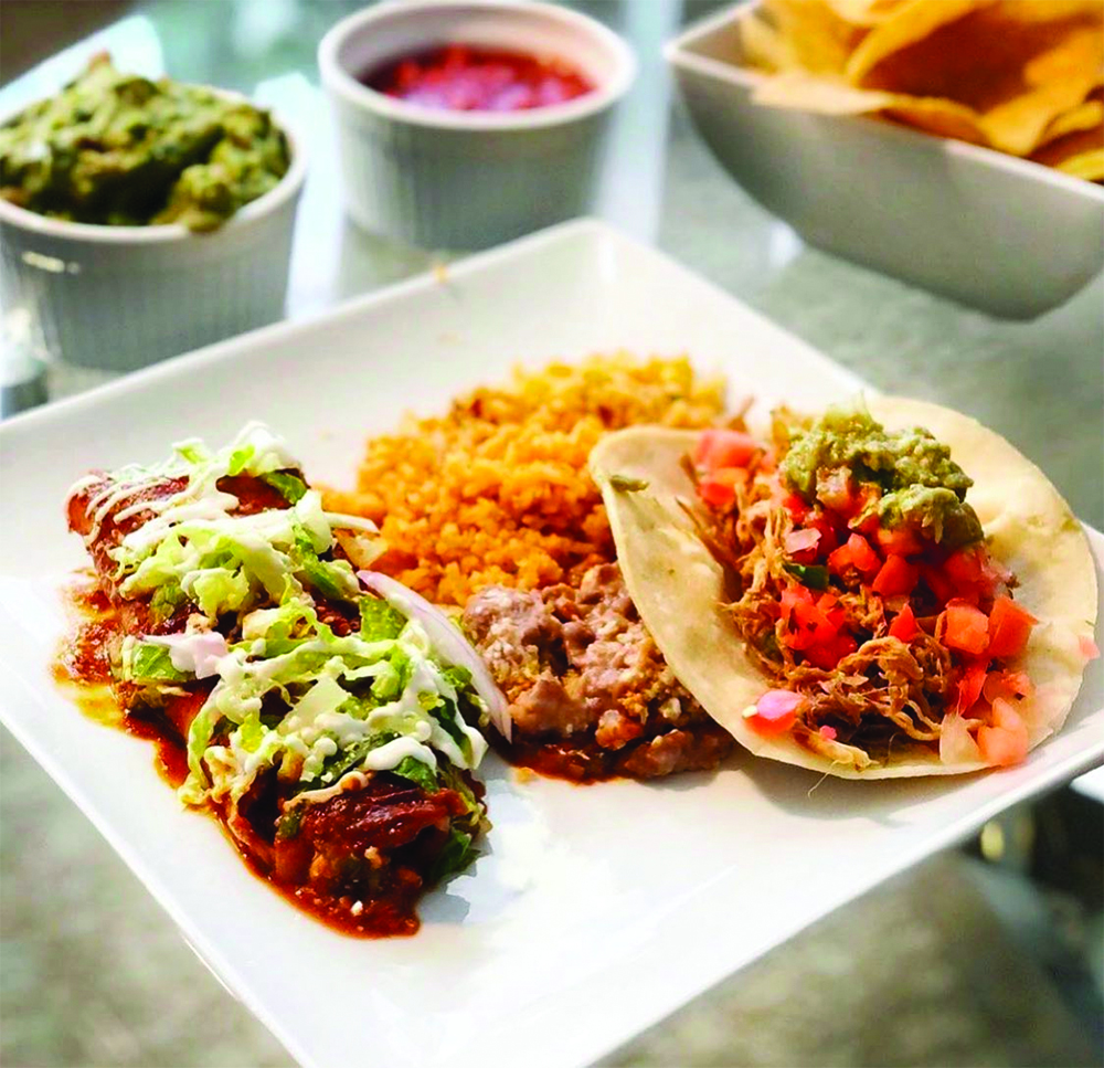 Enchilada, rice, beans and taco from Chile-Tepin