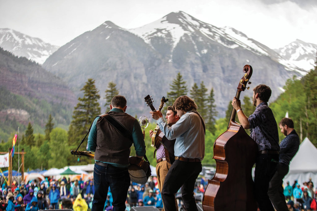 5 musicians perform for a crowd outdoors at the Telluride Bluegrass Festival