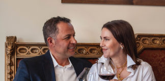 Marco and Amy Stevanoni hold glasses of wine at Veneto