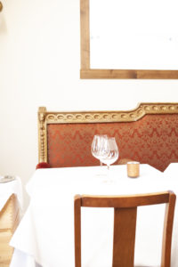 Table setting with wine glasses at Veneto