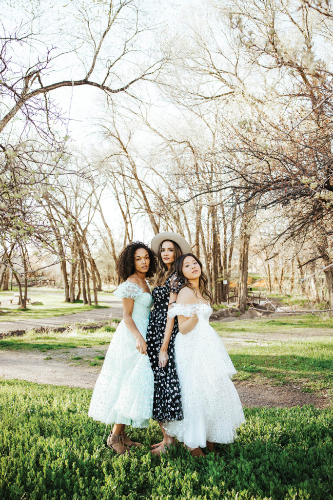Three models in summer dresses from Ava Gowns