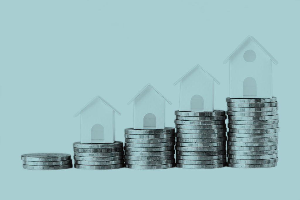 Graphic with rising houses and coins