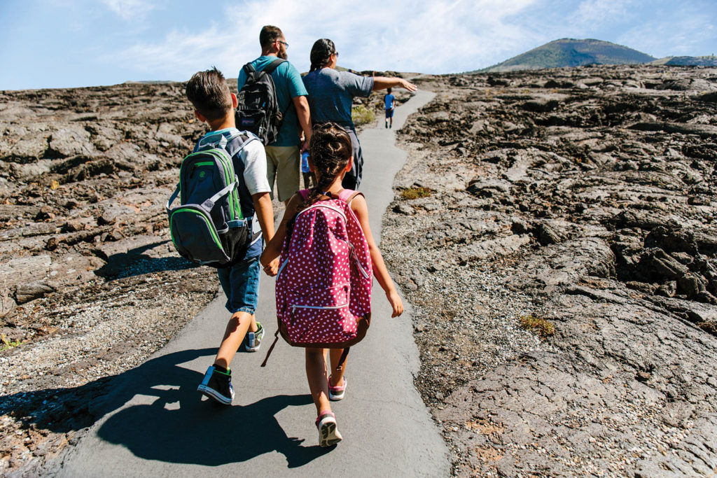A family hiking Craters of the Moon National Monument & Preserve in Idaho