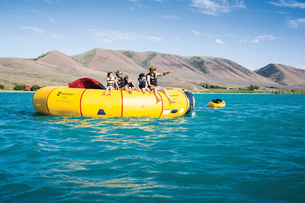 Family sits on water trampoline, Bear Lake State Park in Idaho