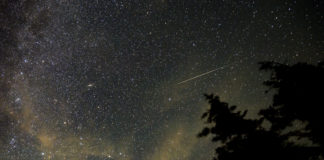 In this 30 second exposure, a meteor streaks across the sky during the annual Perseid meteor shower, Wednesday, Aug. 11, 2021, in Spruce Knob, West Virginia. Photo Credit: (NASA/Bill Ingalls)