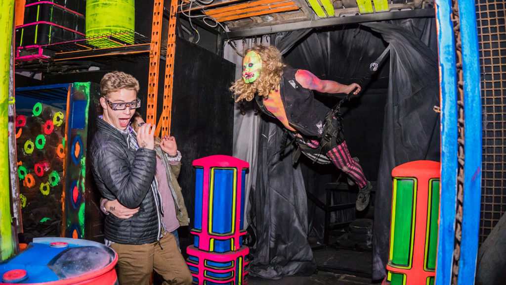 A performer scares a visitor at Fear Factory, a haunted house in Salt Lake City, Utah