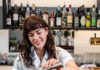 Bartender Mckenzie Foster of Post Office Place mixes a negroni variation with peach aperitif and blanco vermouth